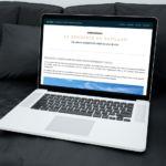 Site Huiban Immobilier sur ordinateur portable